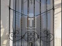 Оконная решетка со скрученными вертикальными стойками (Арт. 029)